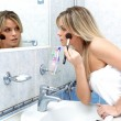 Foto Stock: Woman during daily morning routines