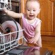 Baby at dishwasher — Stock Photo