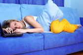 Tired woman sleeping at the PC — Stock Photo