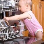 Baby at dishwasher in kitchen — Stock Photo #3171635