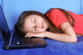 Tired girl sleeping at the PC — Stock Photo