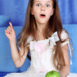 Surprised girl with apple — Stock Photo