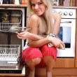 Woman cleaning kitchen — Stock Photo #3376645