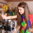 Stock Photo: Girl cooking dinner in the kitchen