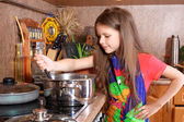 Girl cooking dinner in the kitchen — Stock Photo