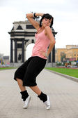 Woman modern ballet dancer in city — Stock Photo