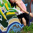 Jumping modern sport dancers in city — Stock Photo