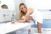 Woman washing in bathroom — Stock Photo