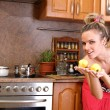 Royalty-Free Stock Photo: Woman holding two apples in the kitchen