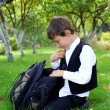 Schoolboy with backpack and apple outdoors — Stock Photo #3819838