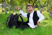 Schoolboy with backpack and apple outdoors — Stockfoto