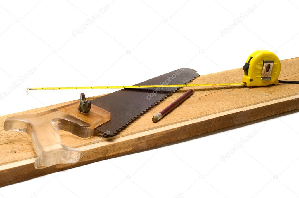 Tools on a board it is isolated on a white background.  Stock Photo #3609041