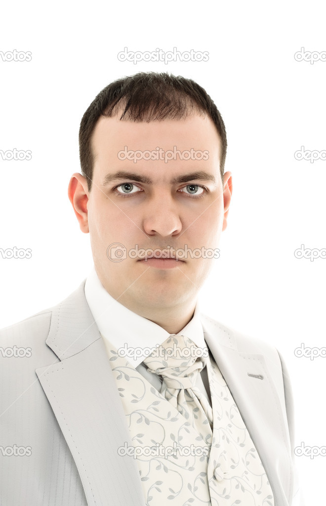 Serious young man in wedding suit isolated on white background — Stock Photo #2822295