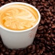 Coffee cup with pattern on foam — Stock Photo