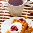 Breakfast with waffles — Stock Photo