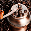 Vintage coffee mill in beans — Stock Photo