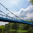Metal bridge over the river — Stock Photo