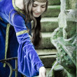 Medieval girl next ancient spring — Stock Photo