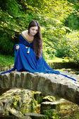 Medieval princess on stone bridge — Stock Photo