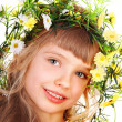 Girl with garland of wild flower. - Stock Photo