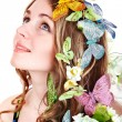 Girl with butterfly and flower on head — Stock Photo