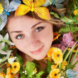 Girl with butterfly and flower — Stock Photo