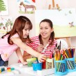 Child with teacher draw paints — Stock Photo #2779333