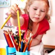 Royalty-Free Stock Photo: Child  with  pencil in play room.
