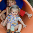 Two children on waterslide. — Stock Photo