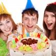 Group in party hat with happy birthday cake. — Stock Photo