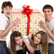 Happy family with gift box. — Stock Photo #3307282