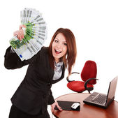 Businesswoman with group of money and laptop. — Stock Photo
