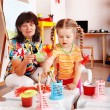 Child with teacher draw paints in playroom. — Stock Photo #3317683