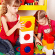 Child with puzzle, block and construction set in play room. — Stock Photo #3317693