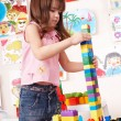 Child with  construction set in play room. - Stock Photo
