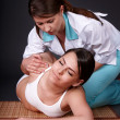 Beautiful girl having thai massage. — Stock Photo