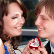 Stock Photo: Mpropose marriage to girl.