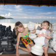 Children play chess nearly sea. — Stockfoto #3318110