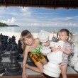 Children play chess nearly sea. — Stock Photo #3318110