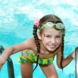 Girl in  goggles leaves pool. — Stock Photo