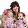 Happy grandmother and two granddaughter. — Stock Photo