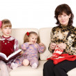 Happy  family grandmother knits, child read book. - Stock Photo