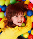 Little girl with group ball. — Stock Photo