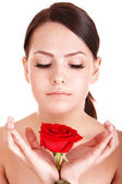 Beautiful girl with red flower. — Stock Photo
