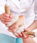 Thai herb compress massage of leg. — Stock Photo