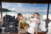 Children play chess nearly sea. — Stock Photo