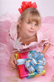 Girl with gift box. — Stock Photo