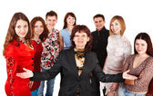Happy group of young with senior. — Stock Photo
