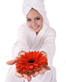 Girl with red flower and white towel on head . — Stock Photo