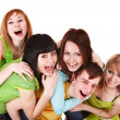 Happy group of young in green. — Stock Photo